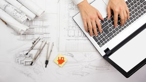 PPT background picture of architectural drawing laptop