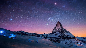 Beautiful cosmic sky under the mountain PPT background picture